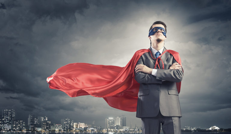 Young confident super businessman in a mask and cape